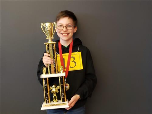 Ben St. Hilaire poses with the trophy he received after winning the 2020 Multi-Region State Spelling Bee